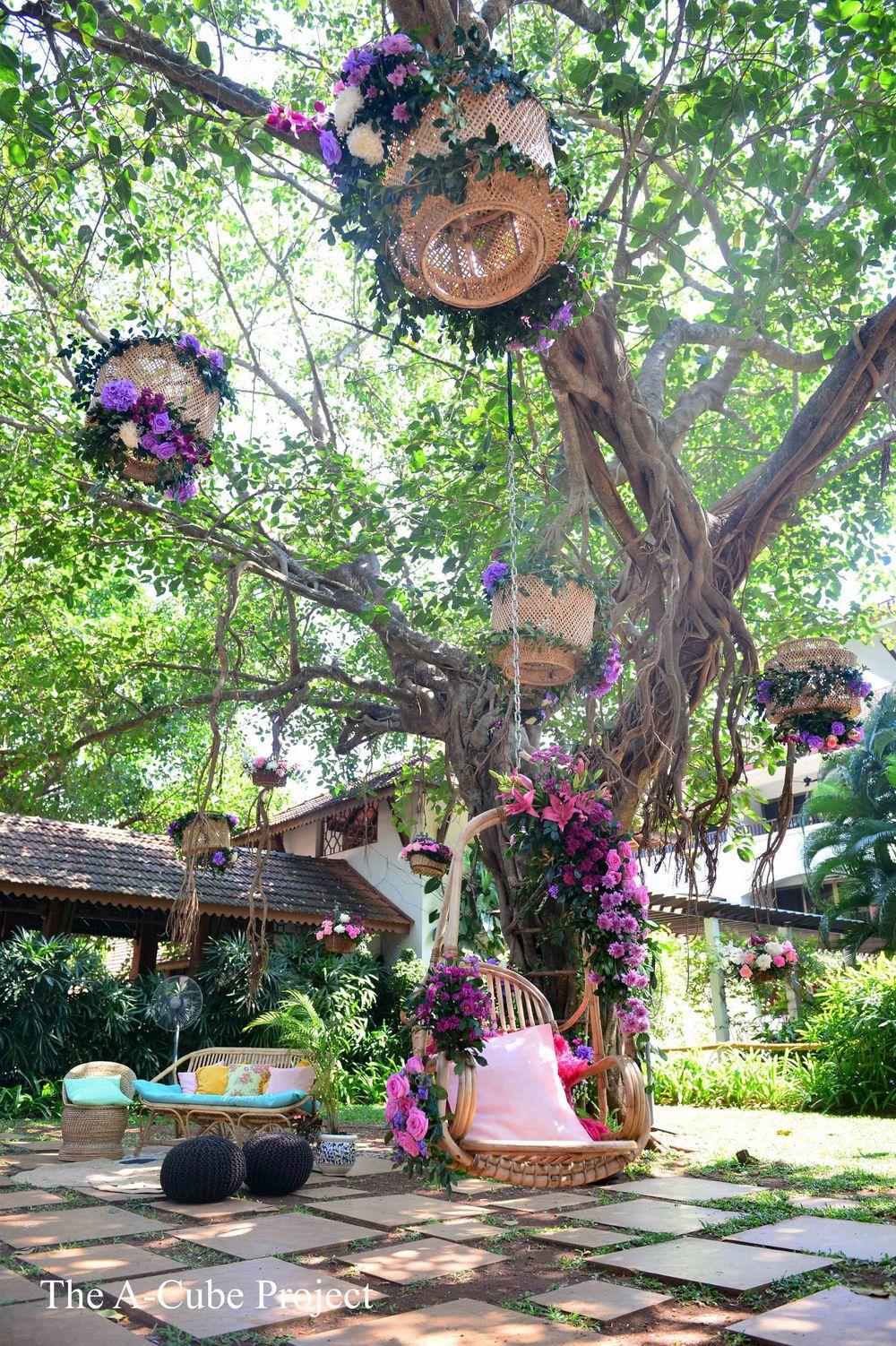 Photo of Jhoola setup with purple flowers and cane baskets.