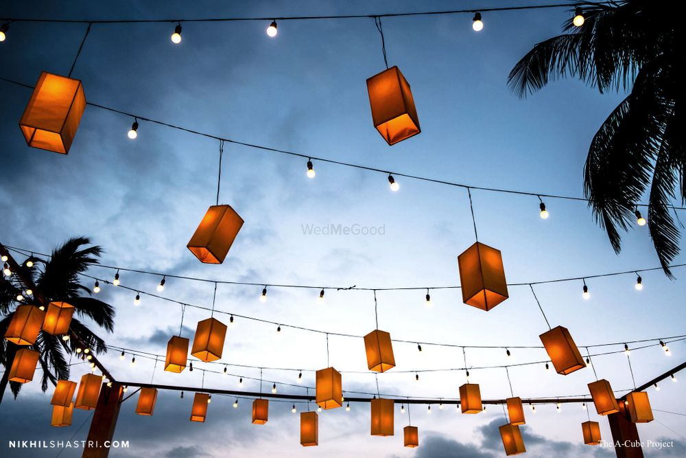Photo of Hanging lanterns with bulbs for ceiling decor.