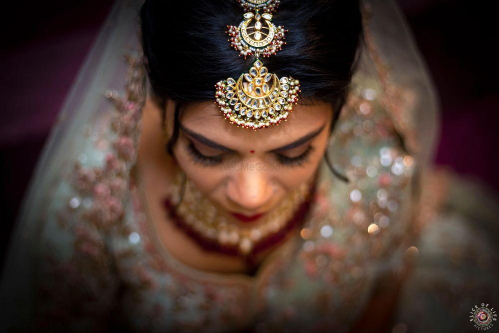 Photo of A bridal mang tikka with chandbaalis.