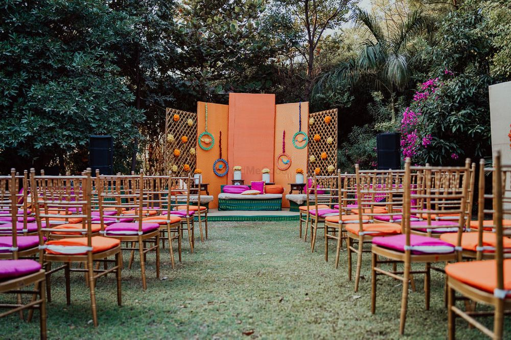 Photo of simple stage and chair decor with peach and pink theme