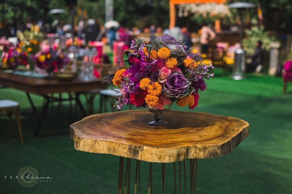 Photo of rustic side table with pretty floral arrangement