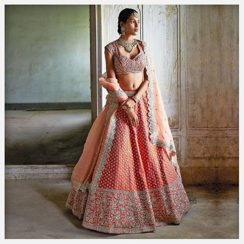 Photo of A coral lehenga with intricate details.