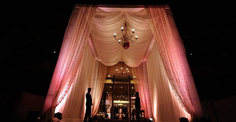 Photo of entrance decor with soft white drapes