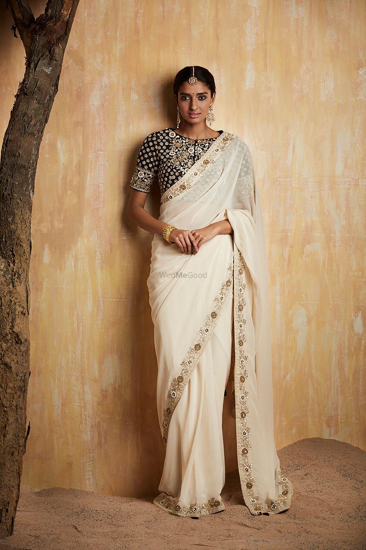 Photo of White saree with black blouse