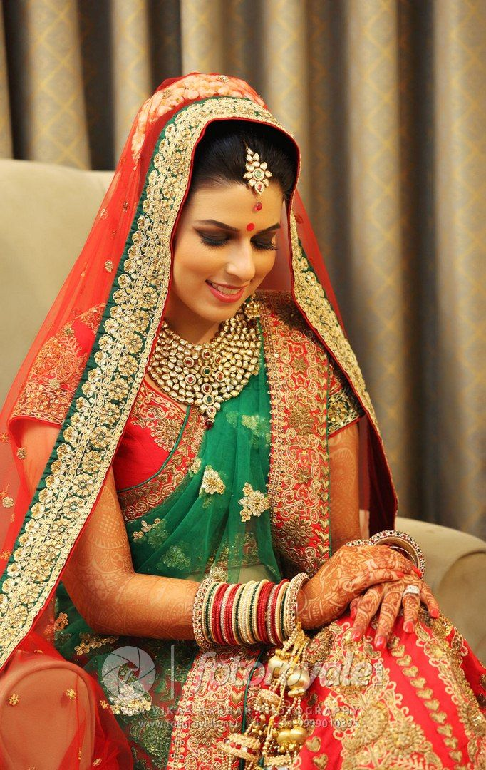 Photo of Punjabi Bride in Red and Teal Bridal Lehenga