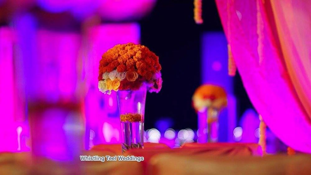 Photo of Centrepieces with Roses in Glasses