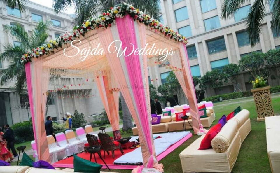Photo of peach pink and white mandap outdoor