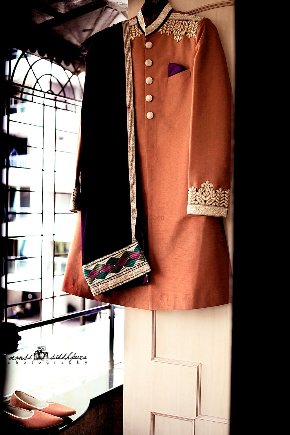 Photo of Brown Sherwani on Hanger with Black Shawl