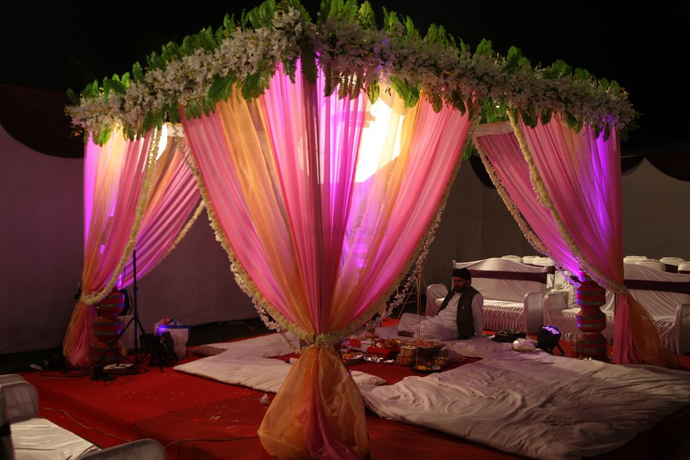 Photo of light pink drapes with light