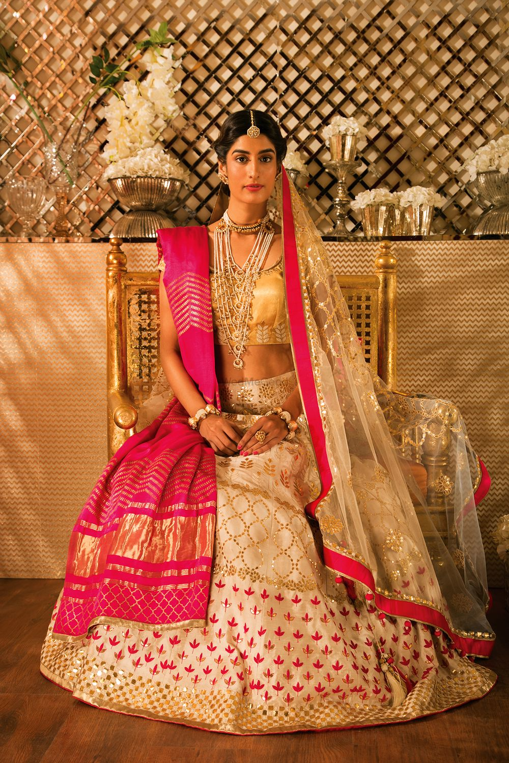 Photo of White and Pink Bridal Lehenga with Gold Blouse