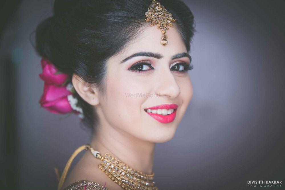 Photo of Bright Pink Theme Bridal Makeup