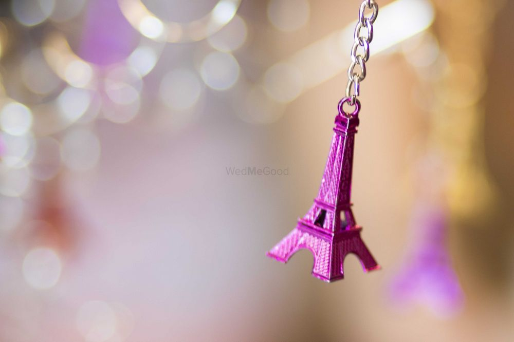 Photo of Miniature Eiffel Tower Hanging in Decor of NRI Wedding