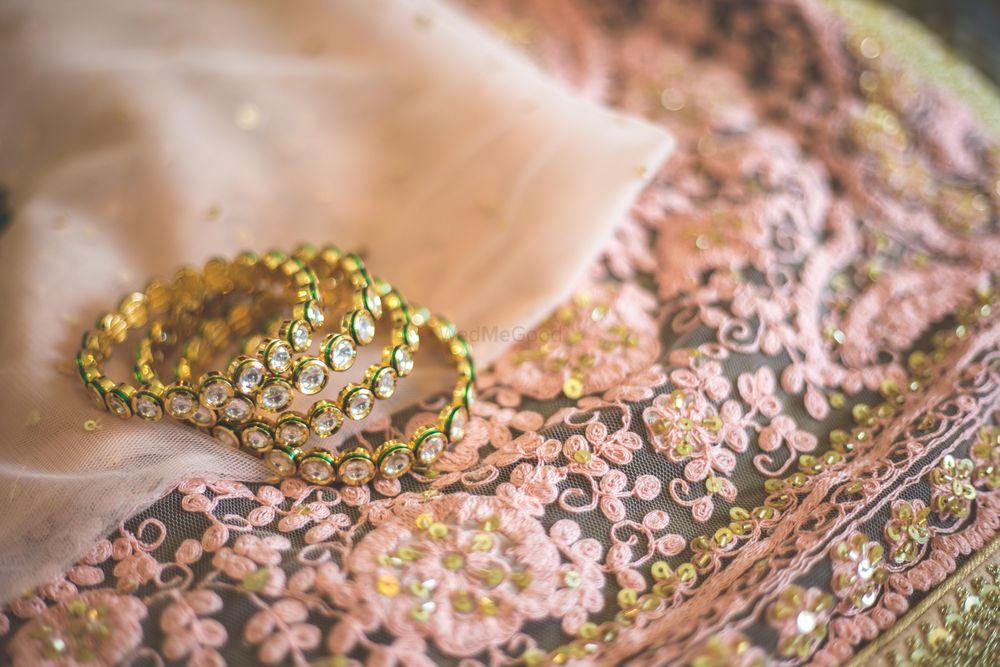 Photo of Kundan bangles on top of bridal dupatta