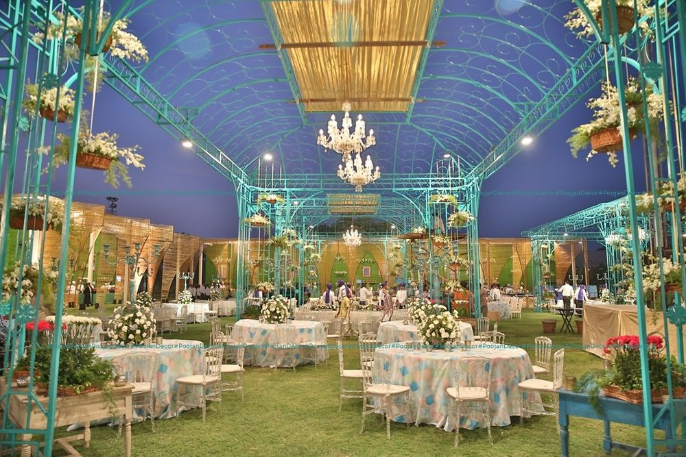 Photo of Blue and white themed indoor venue decor with tables