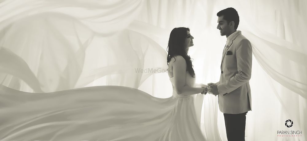 Photo of Pre wedding shoot couple portrait with flowing gown