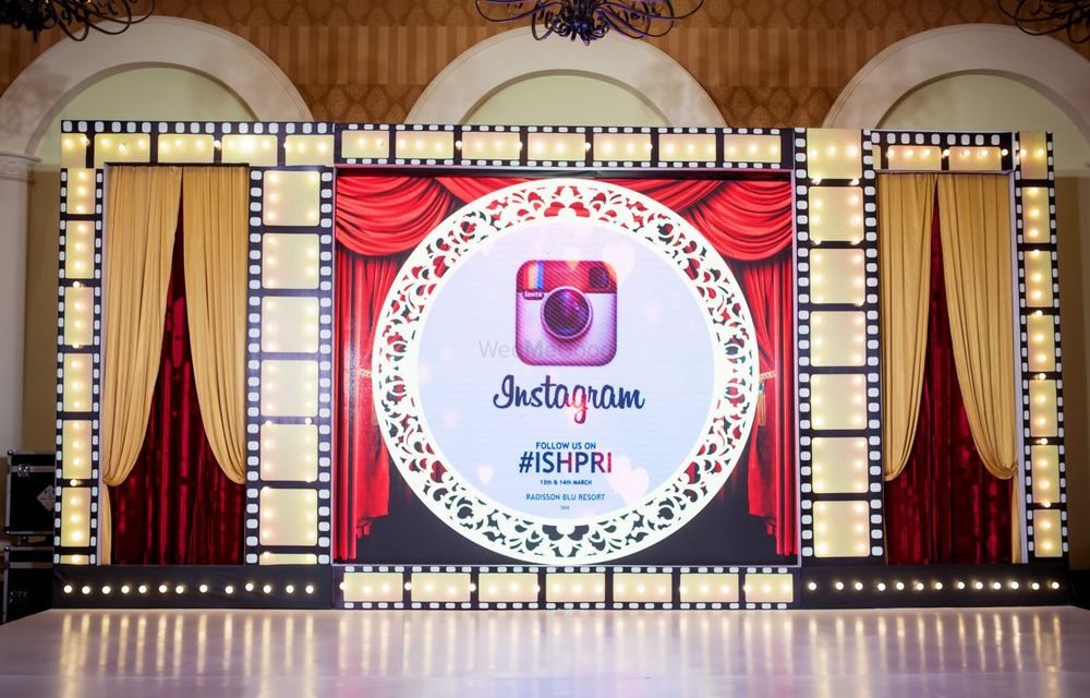 Photo of Theatre theme sangeet with instagram hashtag on stage