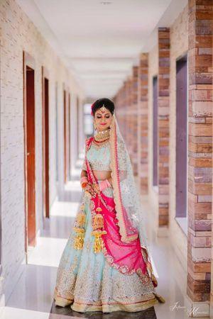A bride in powder blue lehenga.