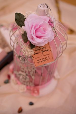 Save the date idea with favours in birdcage