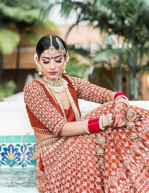 Bridal portrait ideas with bride in burnt orange lehenga