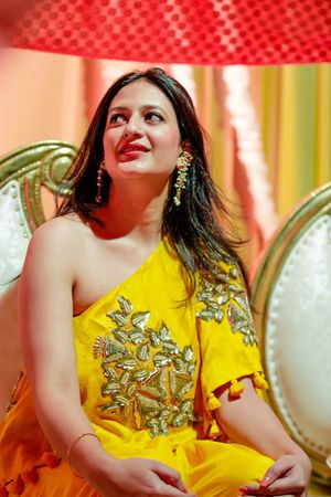 Yellow one shoulder gown for mehendi