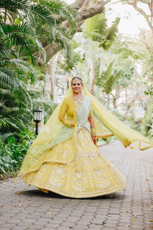 Offbeat bridal lehenga in yellow and mint colours