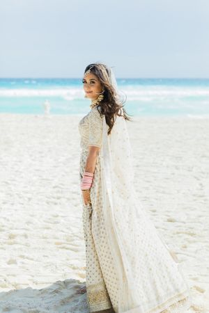 Beach wedding with bride in white