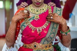 South Indian bridal jewellery with layered necklaces and waist belt