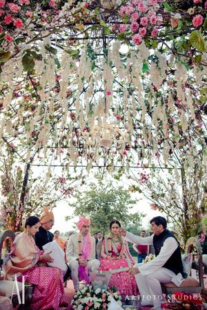 Fairytale mandap decor with hanging floral strings