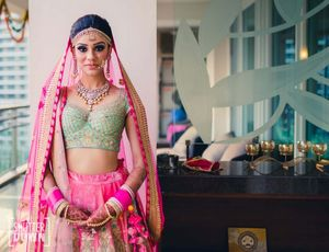 Bright pink and mint bridal lehenga with unique blouse design