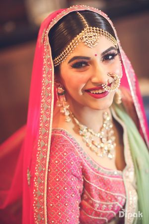 Closeup of a smiling bride in pink