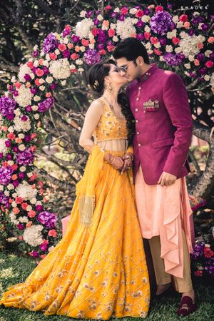 Bride and groom mehendi outfits