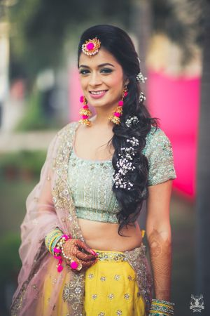 Mehendi bridal look with gota jewellery and open hairstyle