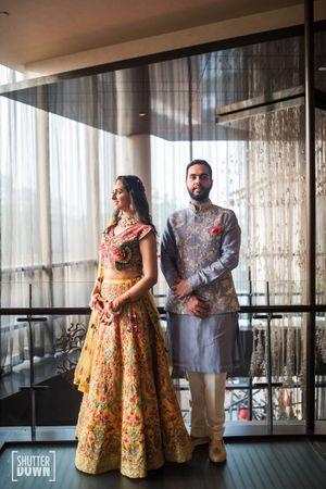 Couple mehendi portrait in offbeat colours