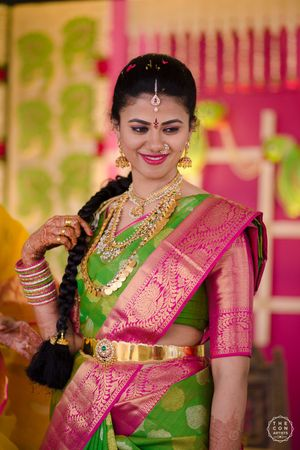 South Indian bridal look in pink and green saree