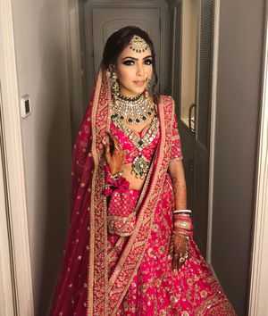 Stunning bridal portrait of an indian bride wearing hot pink lehenga