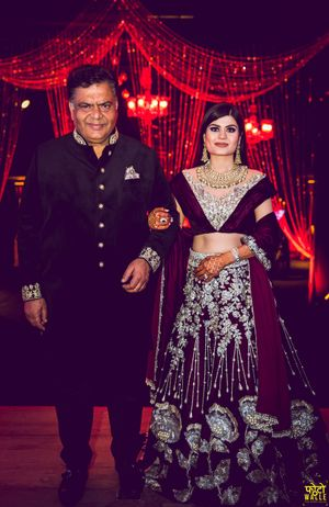 Bride with father in maroon velvet lehenga and unique blouse