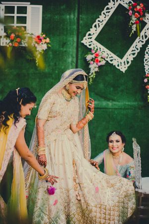 A bride in beige and her bridesmaids