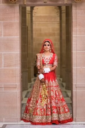 Red and gold bridal lehenga by manish malhotra