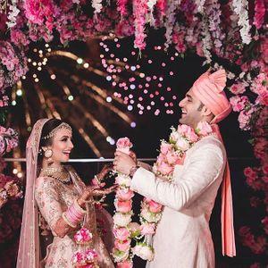 Matching bride and groom in happy jaimala shot