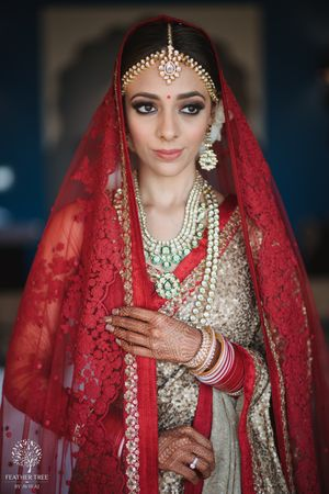 Photo of Wedding day bridal portrait idea in red and gold lehenga