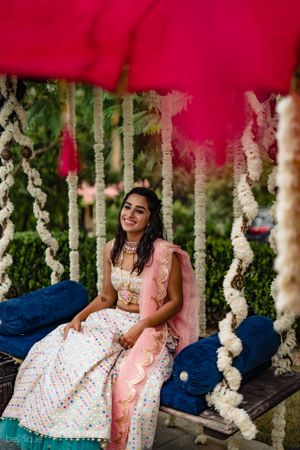 Bride on mehendi portrait on swing