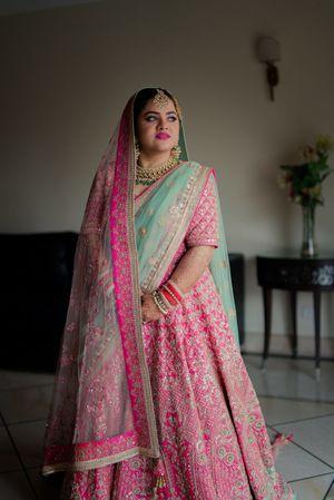 Punjabi bride in pretty pink lehenga for wedding