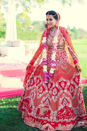 Offbeat red bridal koesch lehenga