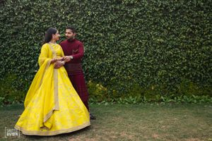 Bride in bright yellow sabyasachi lehenga