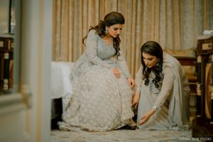 A friend helps the bride on her engagement day