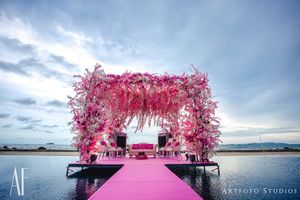 Gorgeous beachside floral mandap in pink