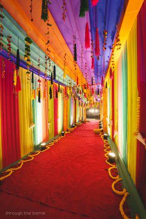 Colourful mehendi entrance decor