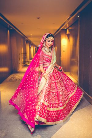 Bright pink and mint lehenga by Anita Dongre