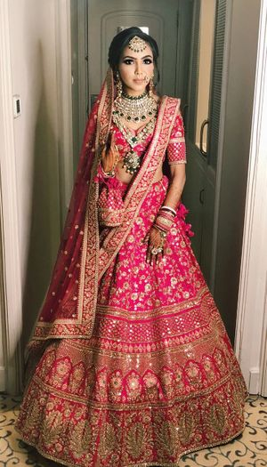 Stunning hot pink lehenga for an Indian bride