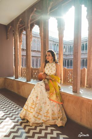Summer mehendi outfit in white and yellow